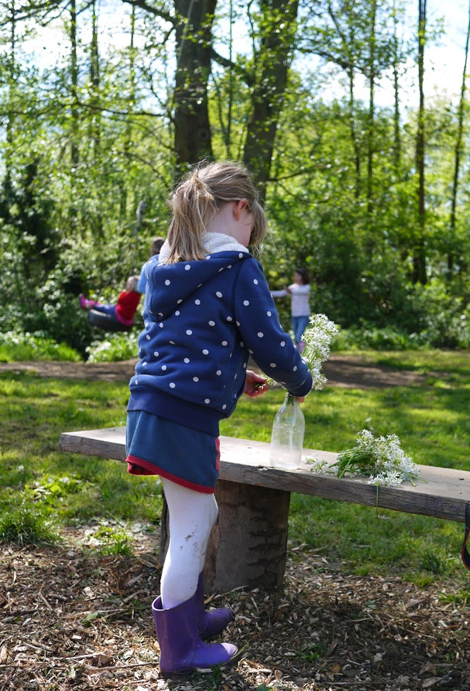 Coco setting up her flower stall at Wowo camp site in East Sussex by Alexis at www.somethingimade
