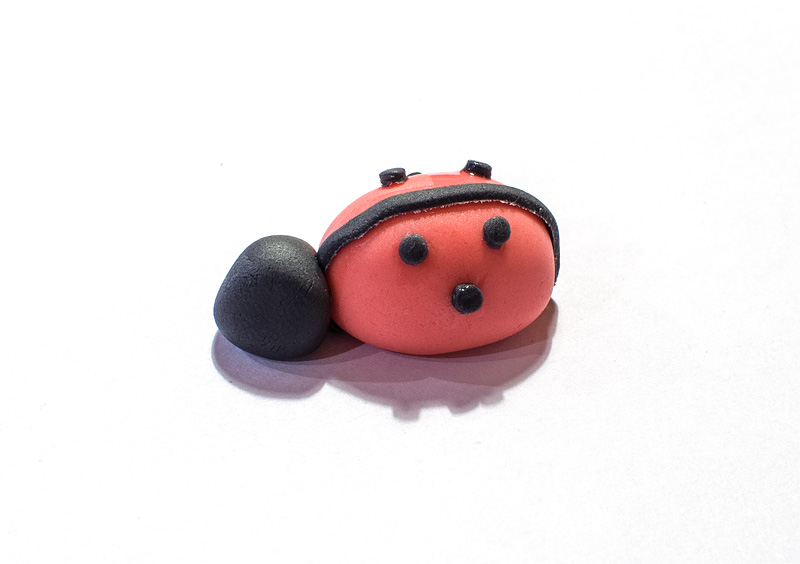 Ladybug fondant figure head on body