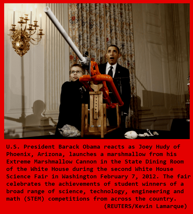 President Barack Obama reacts as a student fires a marshmallow cannon