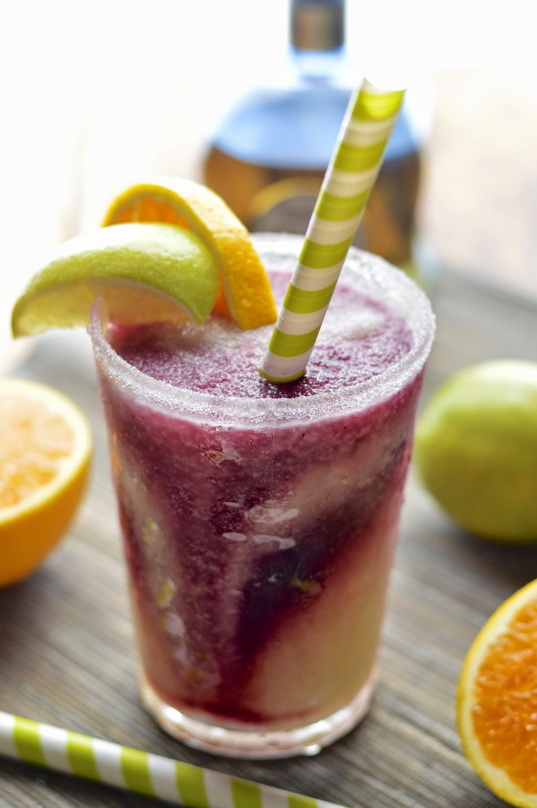 Frozen lime margaritas with a swirl of frosty and fruity sangria - the perfect summer cocktail.