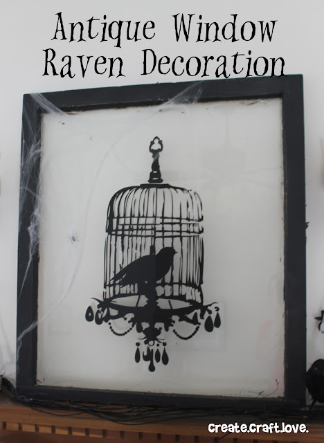 antique window raven decoration
