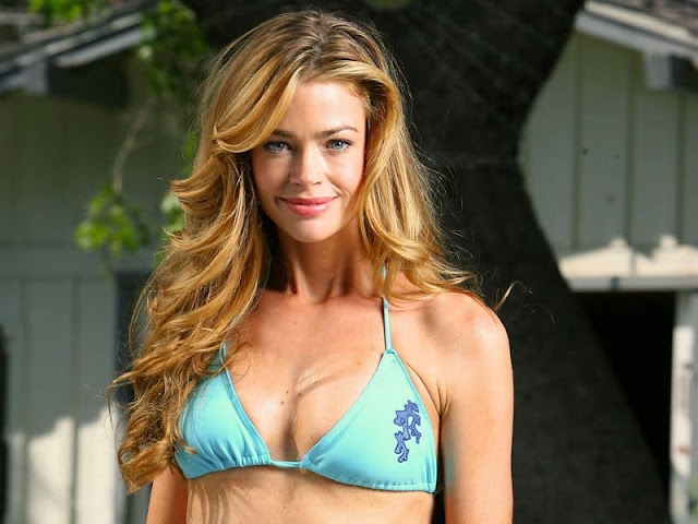Model Denise Richards sexy in blue swimsuit fashion