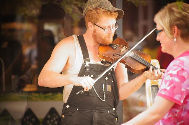 street violinist (street performer) in Asheville, North Carolina