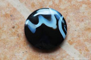 Batu permata akik hitam dengan kalimah Allah