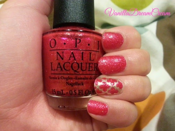 OPI magazine cover mouse nail lacquer is a deep glittery red nail polish