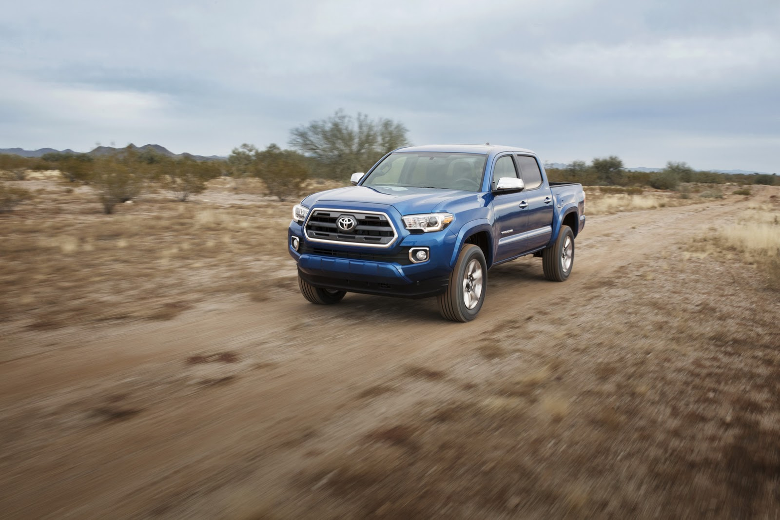 Toyota shares hd pics video of 2016 tacoma pickup truck carscoops photo gallery voltagebd Choice Image