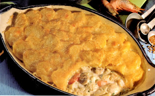 Classic Fish Pie: Traditional fish pie of smoked and white fish in a milk base topped with sliced potatoes and cheese