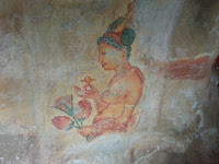 Ancient Lankan Princess Lady holds flowers, fresco graffiti in Sigiriya, world cultural heritage, point of interest