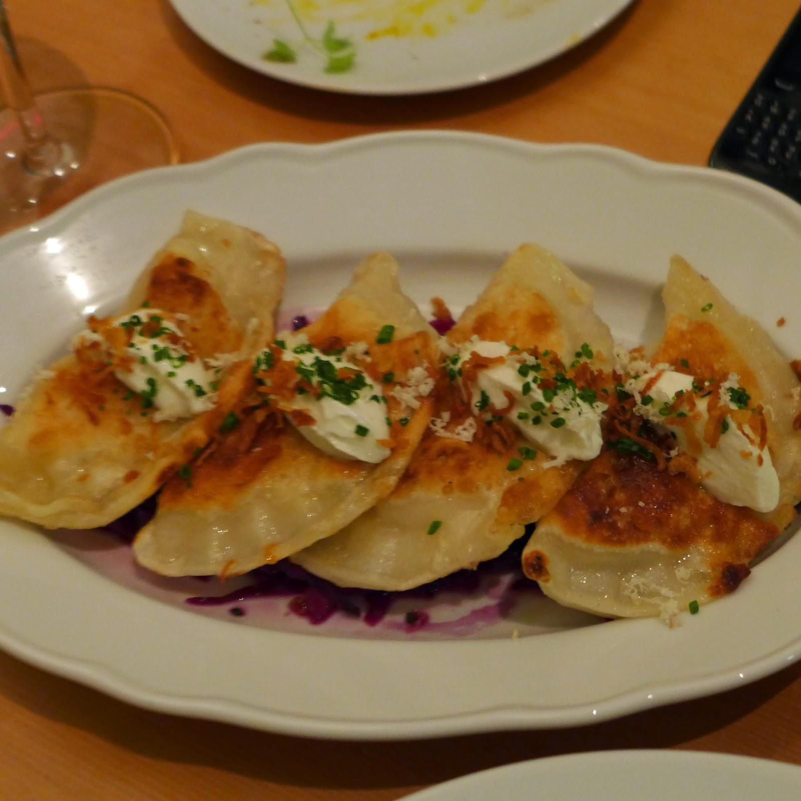 Caramelized onion and potato pirogies with crispy onions, red cabbage ...