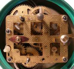 typical clock gears mounted in a frame