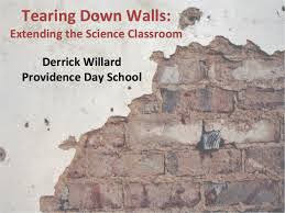 half of a brick wall with the saying:tearing down walls extending the science classroom
