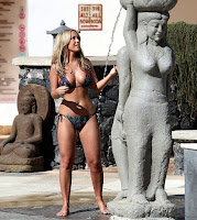 Great situation, of course, as the stunning brunette, Kate Wright, 24, keeping clear her black bikini shapes under the shower on Monday, December 17, 2015 at Tenerife, Spain.