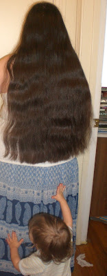 Waist length long hair.