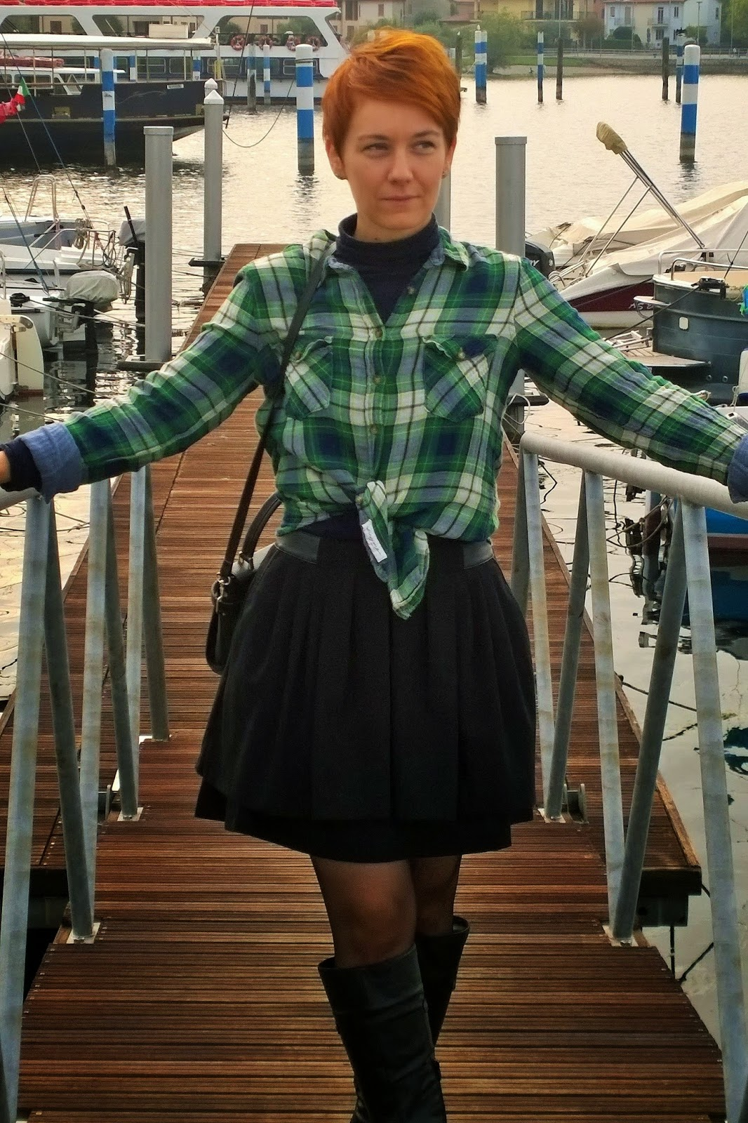 At the marina of Iseo. Fall outfit with plaid shirt, black full mini skirt, riding boots. | Funky Jungle - Mindful fashion & personal style blog