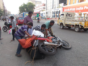 "Lucky escape :- Collapse of overloaded motorcycle on ""Marine Drive  road"" of Ernakulam in Kochi."