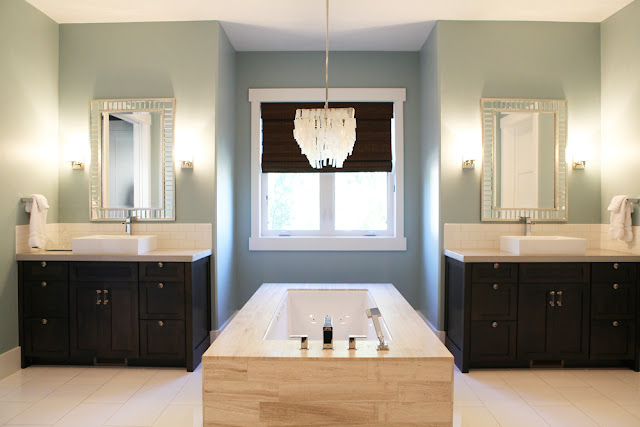 Brooke Jones Designs Master Modern Bathroom Capiz Chandelier Limestone Tub Custom Cabinetry