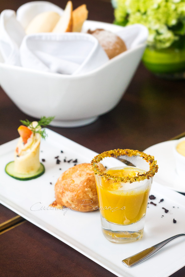 Complimentary Amuse Bouche at Auroz Gourmet Grill. Some wrap, Cheese puff, Pumpkin soup with pistachio crumbs at the rim