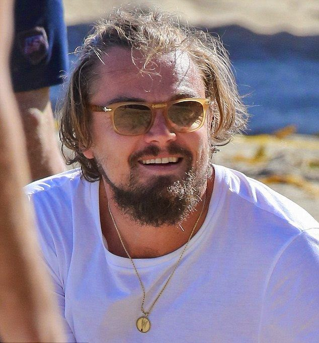 Leonardo DiCaprio and girlfriend, Toni Garrn looked absolutely stunning while playing a beach voleyball with several friends at the beach in Malibu, CA, USA on Sunday, June 6, 2014.