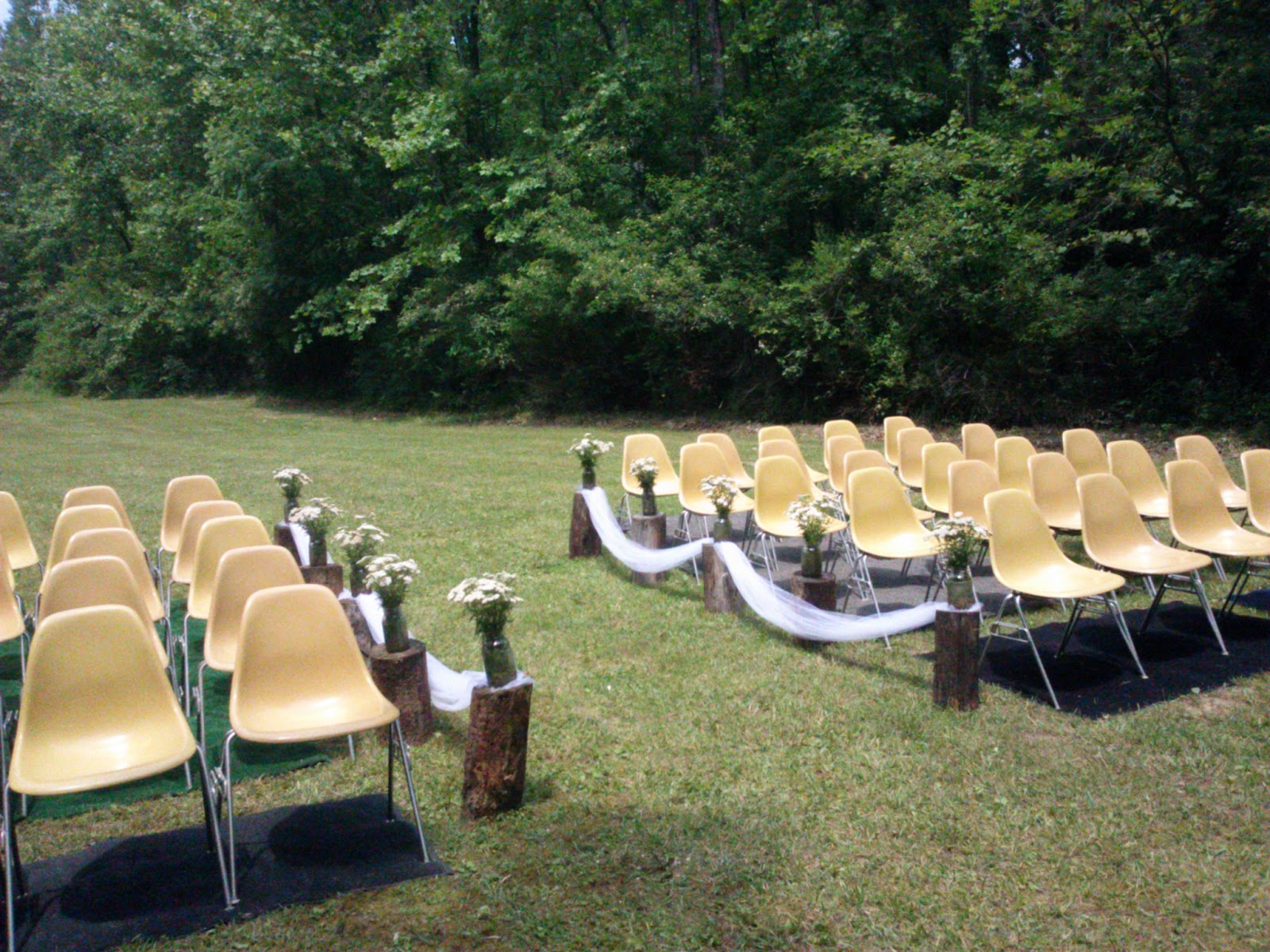 Center Aisle Defined By Upright Logs With Mason Jars And Tulle