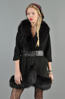 Vintage 1960's black leather princess coat with fox fur trim and belted closure.