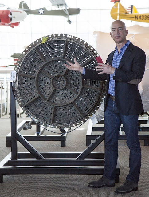 Jeff Bezos at the Apollo rocket engine unveiling ceremony at The Museum of Flight, showing the injector plate from an F-1 rocket used on Apollo 12