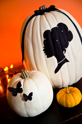 add a chic and feminine touch to your white or pink painted pumpkins by sticking on black crystal embellished butterflies and spray painting the sketch of a