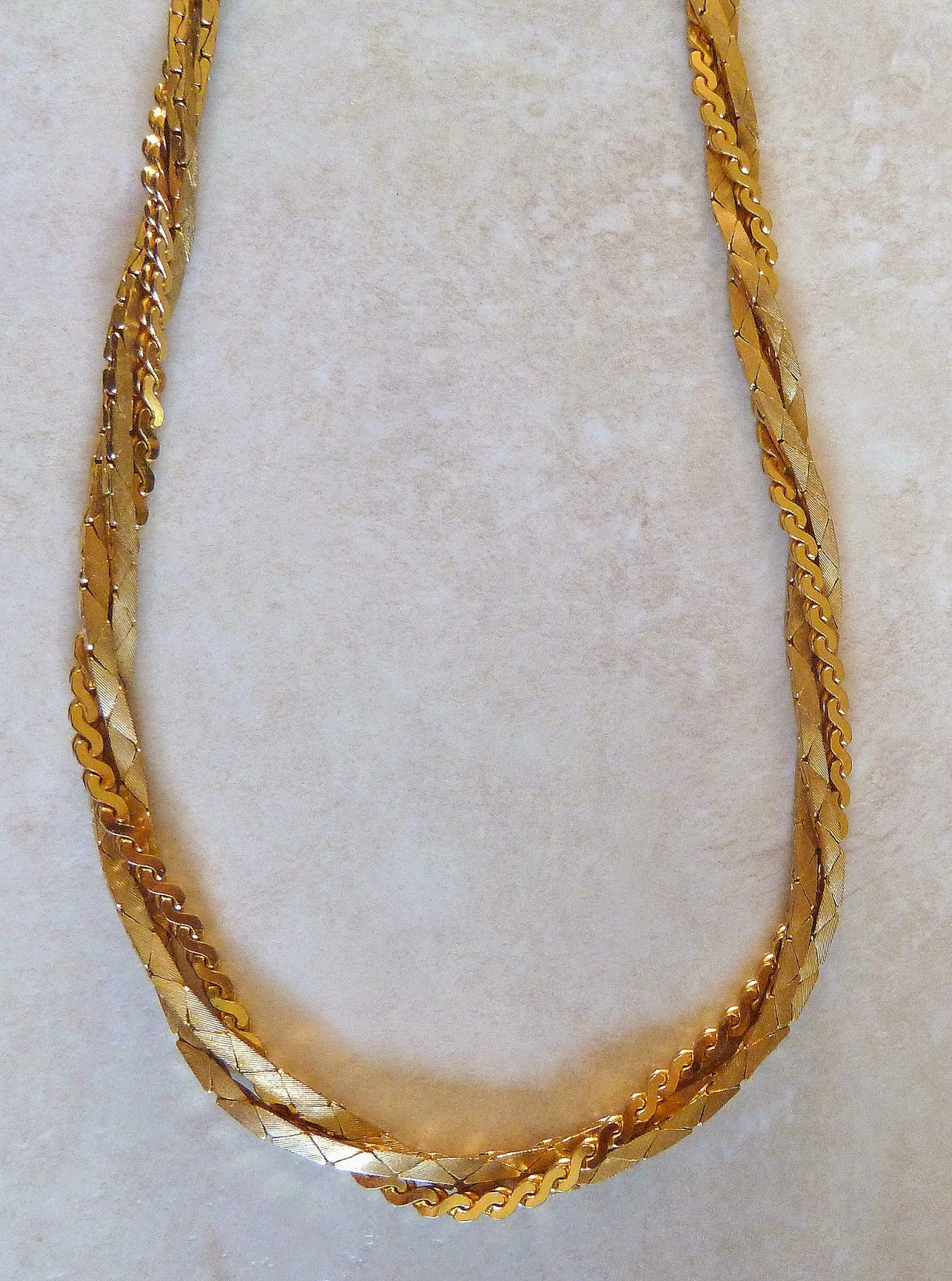 http://www.kcavintagegems.uk/vintage-twisted-three-strand--necklace-414-p.asp