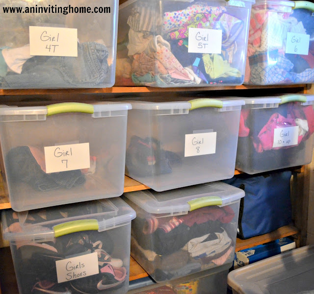 sorting kids clothes in tubs
