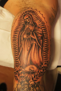 Santa Muerte tattoo: Santa Muerte portrayed as a skeletal version of the Virgin of Guadalupe