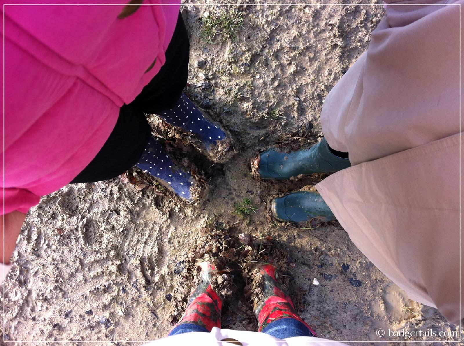 muddy feet in wellies countryside