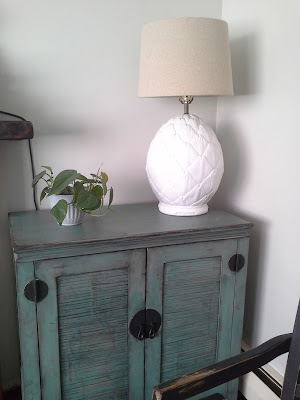 green asian style cabinet pier1 pineapple lamp plants