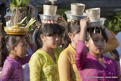 Balinese girls carry offerings to the temple during the Galungal festival, Bali