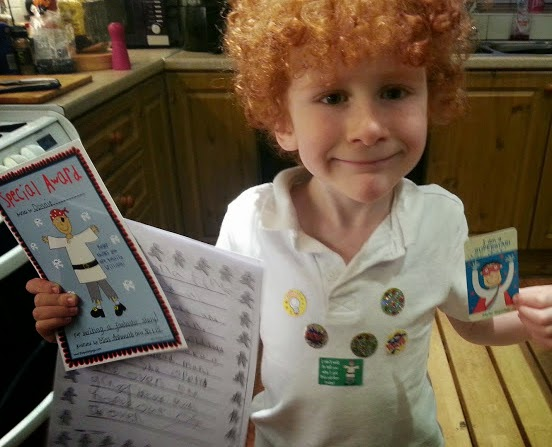 6 year old with lots of class stickers for achievement
