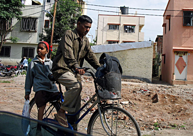 man taking his daughter to school