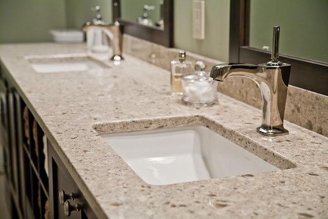 an inspiring brown granite bathroom counter tops with white sinks on it