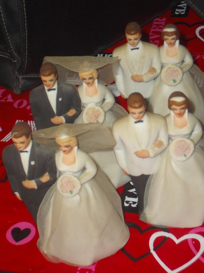 In that process she had found these vintage wedding cake toppers