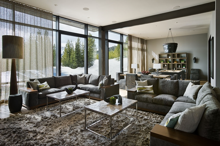 Second living room in Elegant Mountain Home by Reid Smith Architects