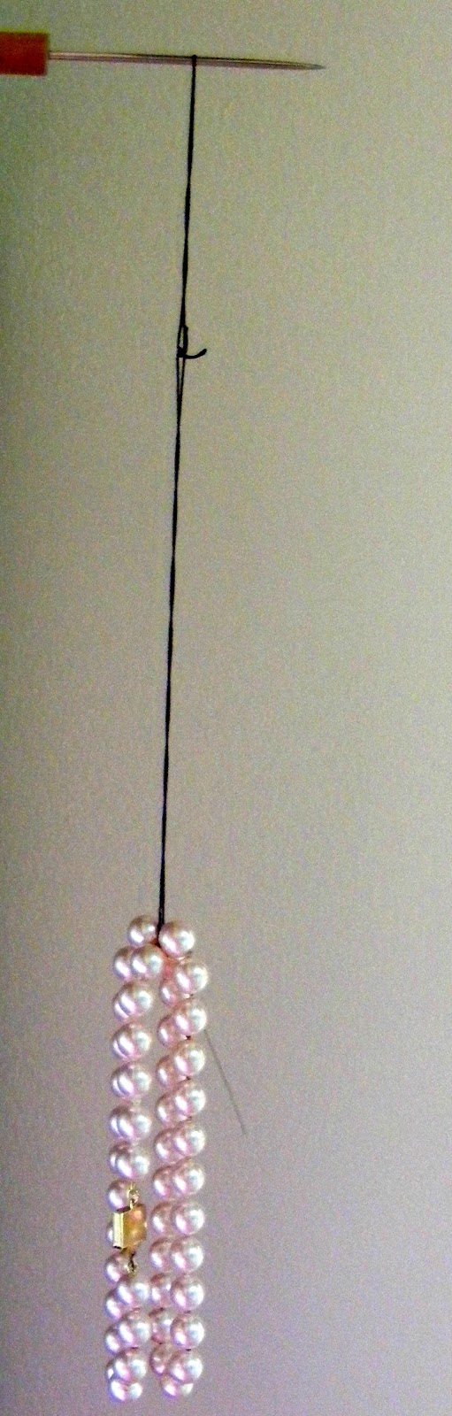 Lindas art barn tips on hand knotted pearl necklaces part 1 here ive looped the thread on a nail to hang it at the bottom i hung the pearls that ill be restringing onto the thread and let it hang overnight to nvjuhfo Choice Image