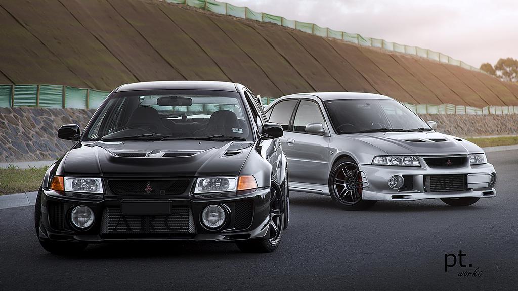 Mitsubishi Lancer Evolution, sportowy sedan, japoński, JDM, tuning, kultowe auto, czarny, srebrny, zdjęcia