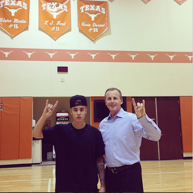 Justin Bieber gives America more reasons to hate the Texas Longhorns in photo with Rick Barnes.