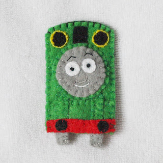 Percy felt finger puppet handmade by Joanne Rich for her friends daughter.