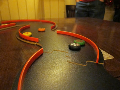 Pitch Car - A close up of the track and cars