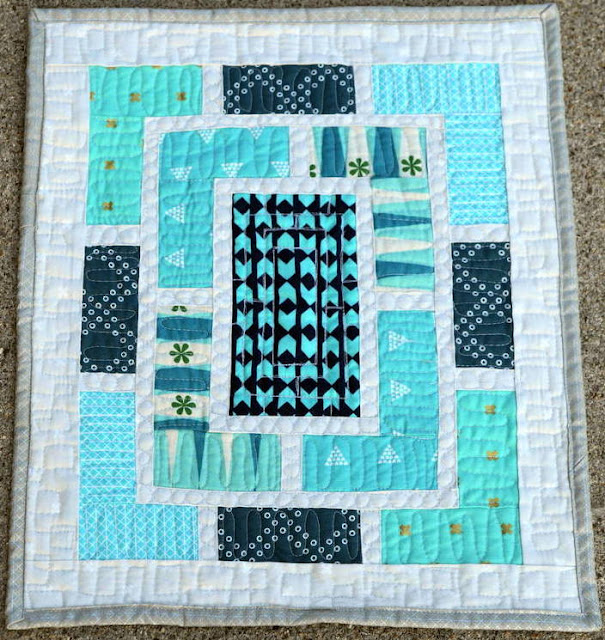 http://quiltyhabit.blogspot.com/2015/06/teal-peek-finished-cotton-and-steel.html