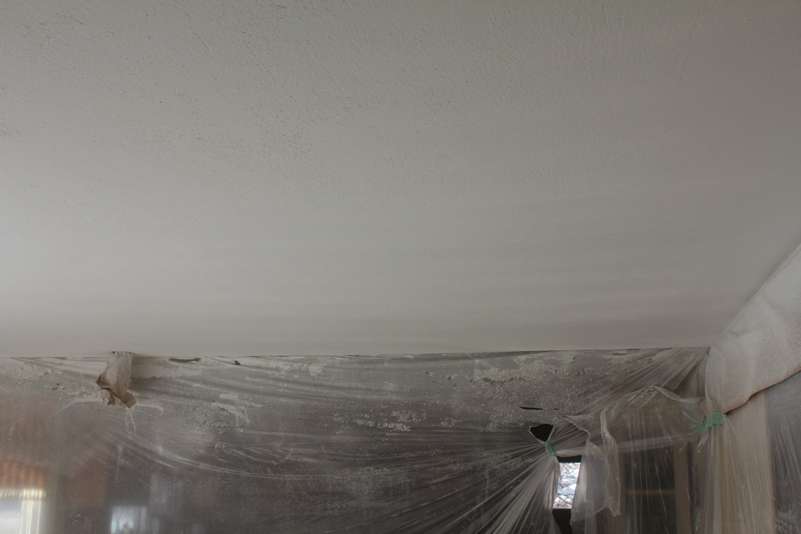 Popcorn texture removal, Knockdown application, step 5: Skim coating the ceiling with a layer of ...