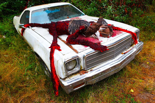 More Oregon car art that looks like a dead animal, perhaps a werewolf, on the hood of an El Camino.