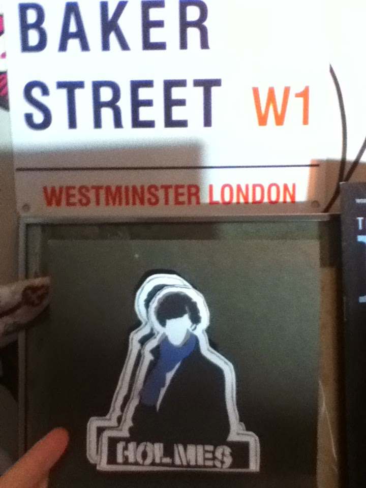 Pop up of the Sherlock character, he has a mop of black hair, blue scarf and a long black coat