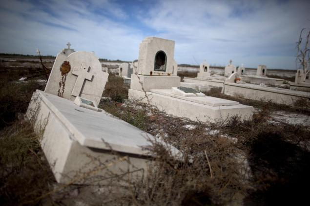 Tombs lay in the ruins of Epecuen, 25 years after the lake overflowed. Water burst through a retaining wall and submerged the lakeside streets in 10 meters of water.