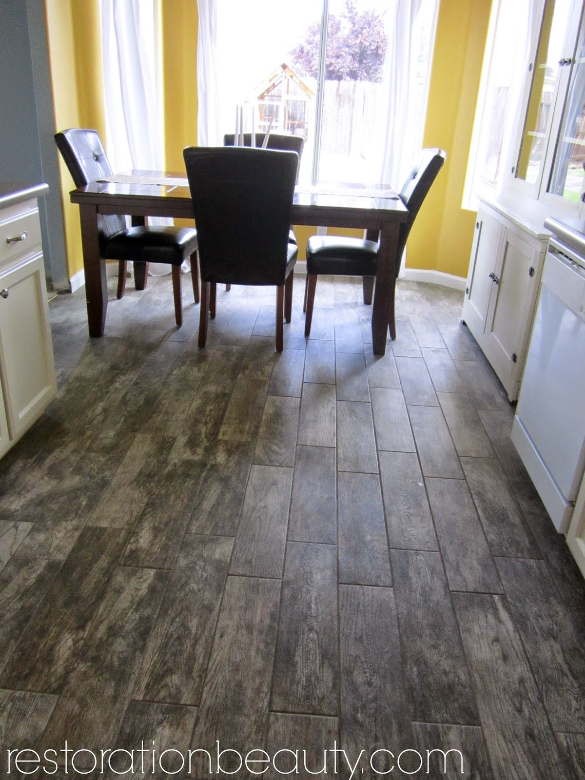 Restoration beauty faux wood tile flooring in the kitchen for Fake hardwood tile