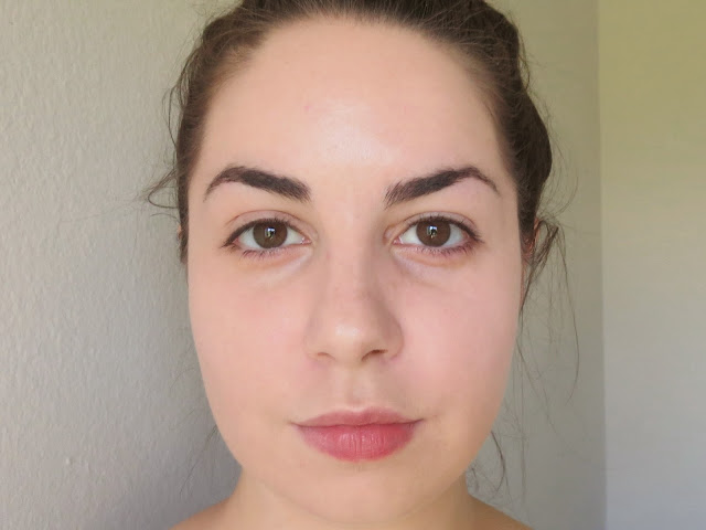 a picture Maybelline Fit Me Matte+Poreless Foundation in 115 Ivory and 110 Porcelain (mixed and applied with beauty blender)