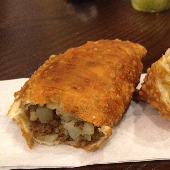this fried empanada was filled with the classic empanada ingredients ...